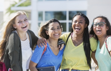 Female students laughing