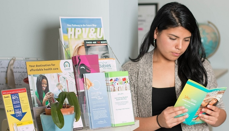 Patient looking at birth control education materials.